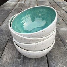 Handmade wheel thrown bowl in lovely turquoise glaze with white glaze with rustic brown tones. Gorgeous set of 4 bowls perfect for home decor,…