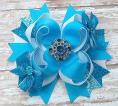 Frozen Elsa Inspired Hair Bow   Blue by JustinesBoutiqueBows
