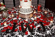 Red Black White Wedding.  Black letters on cake table.  Red roses and votives. Damask Tablecloth