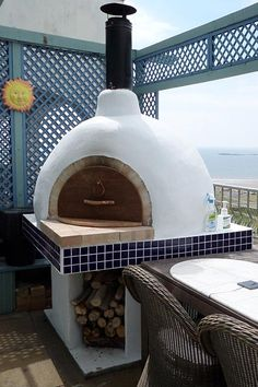 Dome pizza oven with fire bricks, took about 2 months after and a lot of concrete. The oven cooks perfect pizza in 2 minutes