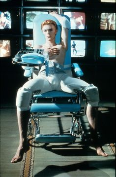 He's got his phone out & he's waiting for your call! (David Bowie in 'The Man Who Fell to Earth', 1976.)