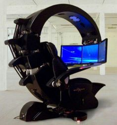 It is not just video game consoles that are becoming techno trash. Video game chairs have consoles and televisions built into them. When this chair breaks, the whole thing becomes garbage. Computer Station, Computer Setup, Computer Workstation, Gaming Station, Computer Rooms, Gaming Rooms, Computer Case, Gaming Desk, Gaming Setup