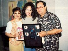 Selena Quintanilla Perez with her parents.