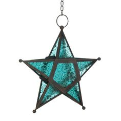 Add a candle to this five-pointed star to fill the night with celestial light! Artistic hanging lantern features ornate panels of deep ocean blue glass set into a wrought-iron frame. Weight 0.8 pounds