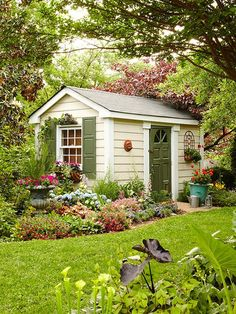 Garden shed surrounded by a lovely garden