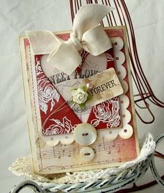 How can you not love this card?  Scallops, music paper, buttons, twill tape (plus we have a heart Accucut die for that heart frame @ Paradise Scrapbook Boutique!) - it's all good!