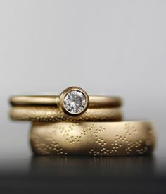 Image of sea and sky modern wedding set - unique gold engagement ring wedding band set