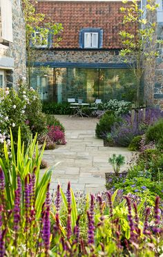 """Beautiful winning gardens from the SGD awards: in pics - The International Award winner was Debbie Roberts for her garden in Le Haut, Guernsey. The judges said: """"An amazing garden with intense displays of co. Small Courtyard Gardens, Small Courtyards, Back Gardens, Small Gardens, Outdoor Gardens, Modern Gardens, Courtyard Design, Modern Garden Design, Landscape Design"""