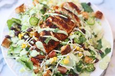 southwest chicken salad with healthy avocado buttermilk dressing food salad chicken salad meat chili garlic lettuce jalapeno tomato mozzarella cheese cilantro avocado dressing buttermilk avocado dressing mayonnaise basil