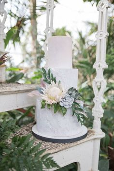 Boho Ibiza Wedding Cake, Peach wedding cake, textured wedding cake, colour washed wedding cake, sugar protea, sugar succulents, sugar greenery Image by Jenny Maden Photography