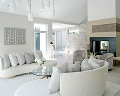A clean, modern interior by Betty Wasserman shows the true power of a minimalistic design. With soft whites, beiges, and hints of natural woods, this design shows how less really can be more while still making a strong statement with plenty of plush textiles and fabrics.