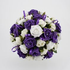 Google Image Result for http://www.theeric.net/wedding/wp-content/uploads/2011/10/Georgous-purple-wedding-bouquet-2011-Oct.jpg