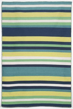 Simple stripe patterns combine with sophisticated blended colors in this indoor/outdoor flatweave. 100% polyester, this flatweave reversible rug is easy to care for and great for any indoor outdoor space. Soft polyester is tightly hand woven by artisans in India with great attention paid to detail such as the serging to create this durable yet attractive indoor outdoor rug.
