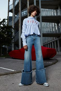 Casual_cropped striped top with expressive logoism paired with deep cuff flared denim | Saved by Gabby Fincham |