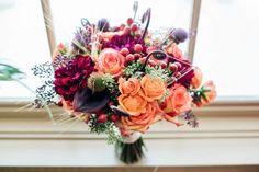 Bouquet has orange and maroon flowers, Indigo Run Clubhouse, Hilton Head, South Carolina Kate Timbers Photography. http://katetimbers.com #katetimbersphotography // Charleston Photography // Inspiration