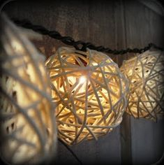 DIY outside lights. All you need is a strand of lights & a package of grapevine balls from the dollar store or craft store. Yep! That easy. Oh, if you want to get fancy, a can of spray paint.