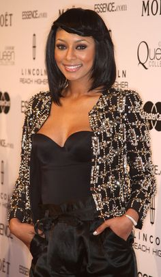 Keri Hilson Medium Straight Cut Ms. Keri Hilson looked amazing at the Women in Hollywood Luncheon. Her braided pinned back bangs were the ultimate accessory to her beaded cropped jacket.