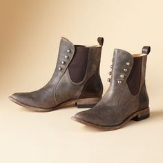 From Lucchese's Spirit collection comes spats-inspired style for the modern girl. They're instant classics made of smooth leather with elastic insets and the wink of burnished studs. Imported. Whole and half sizes 6 to 10, 11.View our entire