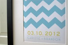 The custom of having guests sign a mat around a framed photo has been around forever. Instead of using a typical photo, use a customized graphic print, like this chevron version. After the wedding, find a perfect spot display it. Your guests will love seeing their names displayed on your wall well after the wedding.