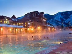Glenwood Hot Springs, Colorado Guests at this Colorado Rockies lodge relax in the world's largest hot springs pool, where 3.5 million gallons of nearby Yampah Springs water flow into one of two bubbling mineral pools daily. The temperature in the smaller therapy pool is a steamy 104 F. The larger pool, which measures more than two city blocks, is kept at a balmy 93 F.