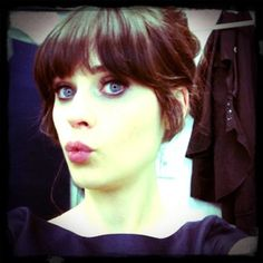 Zooey Deschanel...   Quirky... happy... indie... girls girl. One of the founders of hellogiggles... check the site out... Looove. it.