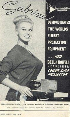 Vintage ad for Bell & Howell's projection equipment -- is this for real? Yes, she's projecting her equipment very well, I'd say!