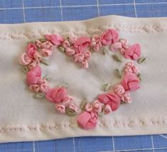 I ❤ ribbon embroidery . . . Romantic Roses Tutorial- Silk ribbon embroidery is my absolute favorite form of embellishment. If you take a look at my gallery of collector doll clothes, you'll see that I added silk ribbon roses to just about every design. It is such a great way to give dimension & vintage sweetness without a lot of time or effort. In fact, I find silk ribbon embroidery to be MUCH easier than floss embroidery. For this project, I used four different ribbons . . .