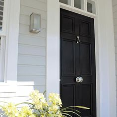 We designed this front door with bolection mouldings to compliment the style of our traditional coastal home new build in Newport Beach. Door knob and knocker Weatherboards Project by us Newport Beach House, Interior Door Knobs, Black Front Doors, Door Knobs And Knockers, Exterior Color Schemes, Facade House, Home Reno, Coastal Homes, Coastal Style