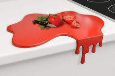Splash Cutting Board: Designed to remain stable while you work, the durable surface will hold up to all of your cutting needs.