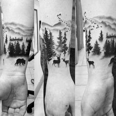 Man With Wrist Tattoo Of Forest And Wild Animals In Nature