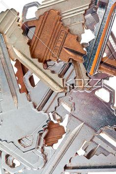 close-up shot of old metallic keys. - Detailed shot of old fashioned metallic keys on plain white background.
