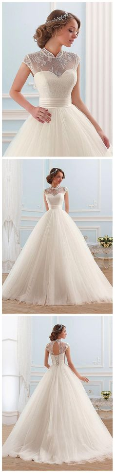 Glamorous tulle high collar neckline ball gown wedding dress.  This modern princess ball gown wedding dress features a number of sweet details.