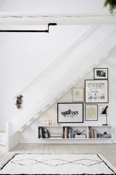 White Moroccan rug + gallery wall under stairs