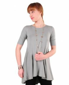 Comfy USA M675 Kerry Tunic $84 Comfy USA Kerry Tunic has round neckline, short sleeves and high-low hem. Back view- peplum skirt comes around front sides. Figure flattering!