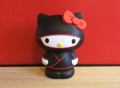 Customized Hello Kitty Collectible Vinyl Toy  So darn cute! Artist, Craig Galentine, does some amazing art.