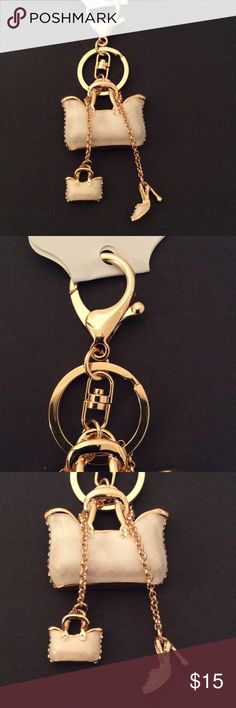 Cream Handbag and Shoe Keychain This Keychain has a large purse, a small purse and a Shoe. It's accented with Rhinestones on every piece. It's equipped with a sturdy ring and clip. You will enjoy this piece. Only 1, get it now. Accessories Key & Card Holders