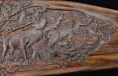 Relief Carving   Pictured is a beautifully carved game scene on a rifle stock.