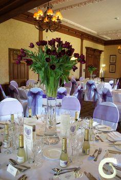 Tall vase arrangement of plum tulips - spring tulip wedding centrepiece - Laurel Weddings