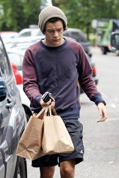 Harry in London today... im going t buy harry a new beanie.. he really needs one