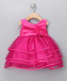 Much like living in a fairy tale, this dress turns every little girl into the perfect princess with layers of gauzy material and ribbon trim. Its rose pin and pleated bodice combine with a zippered back to capture all the grace that's associated with happily ever after. 100% polyesterDry cleanMade in the USA