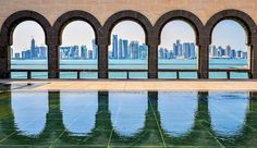 Wondering what to wear in Qatar [or another hot, conservative country]? Learn how to dress for Doha from to day to night, all year long, plus tips on being stylish and comfortable at the beach!