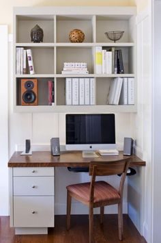 A small office area in the kitchen remains in keeping with the rest of the design.