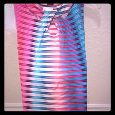 NWOT New York & Company Multi-Color X-Cross Top NWOT New York & Company Multi-Color X-Cross Top.  Pink and blue accents.  Bright colors.  Sleeveless with white horizontal lines across.  Stretch material.  Size XL.  Chest approx 20.5 in.  95% polyester.  5% spandex.  Perfect for business or casual!   Great for spring!   New York & Company Tops Blouses
