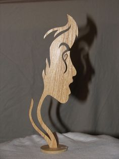 "Girl Face Silhouette. This particular work is 1/8"" thick, giving it a more delicate appearance. Normally made out of Oak, we have had requests for other materials, such as Lexan."
