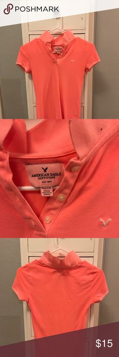 American eagle colored shirt Salmon colored American eagle shirt perfect for school dress codes. XS and very comfortable American Eagle Outfitters Shirts & Tops Polos