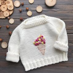 What a great way to knit several colors at the same time!Ravelry: Lotusblomstkofte / Lotus flower jacket sweater knitting pattern by Marianne J. Baby Boy Knitting Patterns, Baby Hats Knitting, Knitting For Kids, Baby Patterns, Knit Baby Sweaters, Knitted Baby Clothes, Cute Baby Clothes, Crochet Clothes, Crochet Outfits