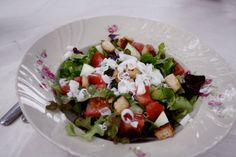 Aunt's summer salad with goat cheese, served on great-grandma's Arabia plate