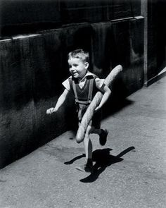 Willy Ronis. Kid with baguette