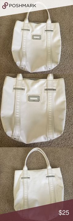"Guess arm candy white glossy shopper shoulder tote Trendy and fun Guess arm candy white glossy shopper shoulder tote. Features double handles, zipper top, zebra stripe lined interior with zipper pocket. Dimensions: 14.5"" x 7.75"" x 11.5"". Straps are 21 inches long, 1 inch wide, 9 inch drop. Guess Bags Shoulder Bags"