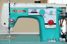 Vintage sewing machine - I love the color, a sewing machine is on my wish list.  Would love this one!